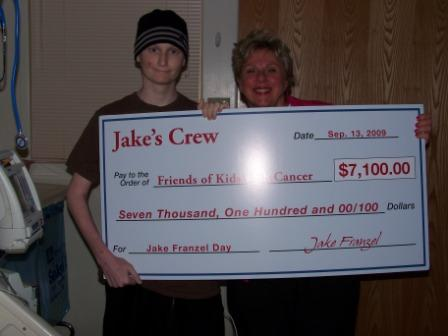 Jake Franzel presents his check to Judy Ciapciak, Executive Director
